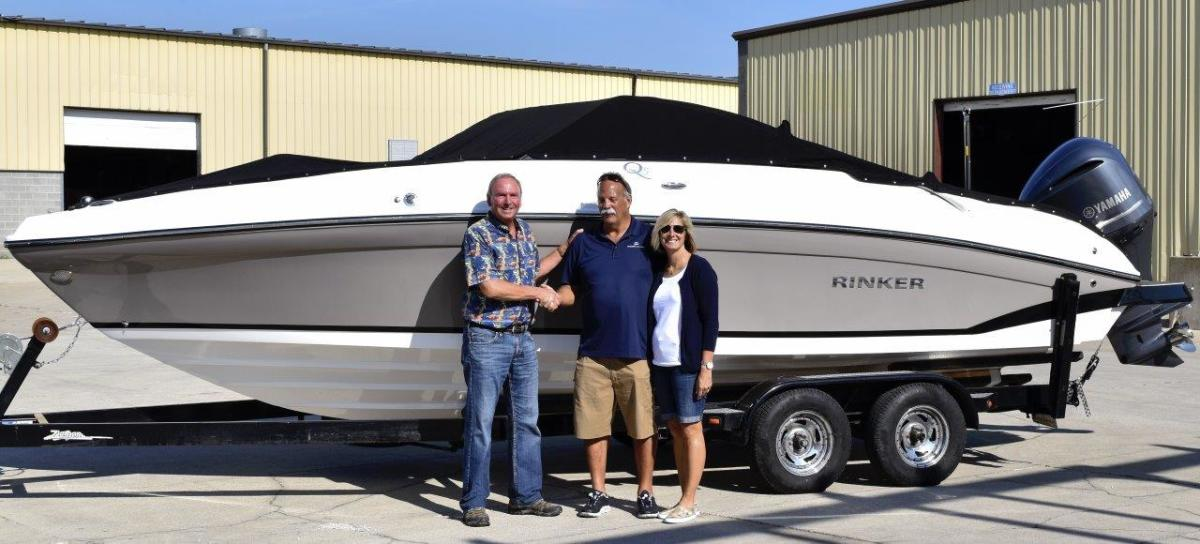 Shown are Kim Slocum (left), president of Rinker Boats, and Rick and Robin Dobreff, co-owners at Freedom Boat Club in Lake St. Clair/Detroit.
