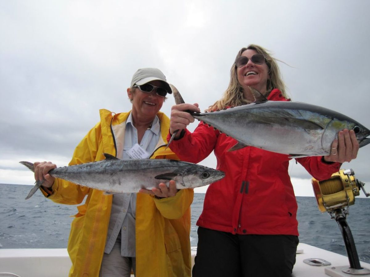 Kathleen Tylman (left) and Angela Fallett are shown with a king mackerel and a blackfin tuna that were caught during the event.