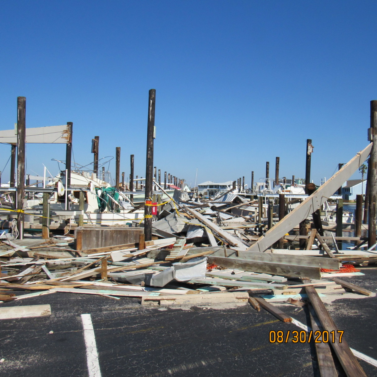damage to boats and structures at Key Allegro Marina in Rockport, Texas