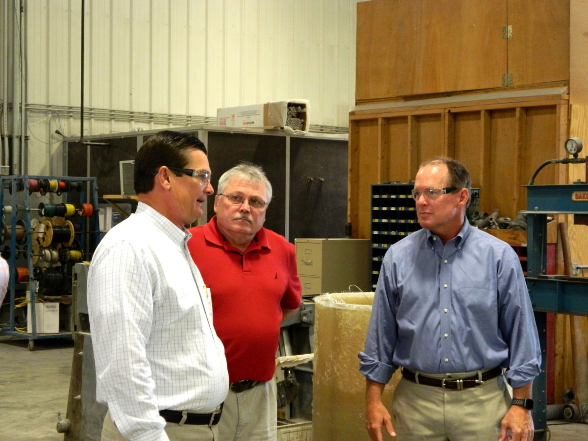 U.S. Rep. Austin Scott, (R-Ga.) (left) is shown in photo with Ken Hartsel, vice president of operations at Centek, and the company's CEO, Bill Hodges