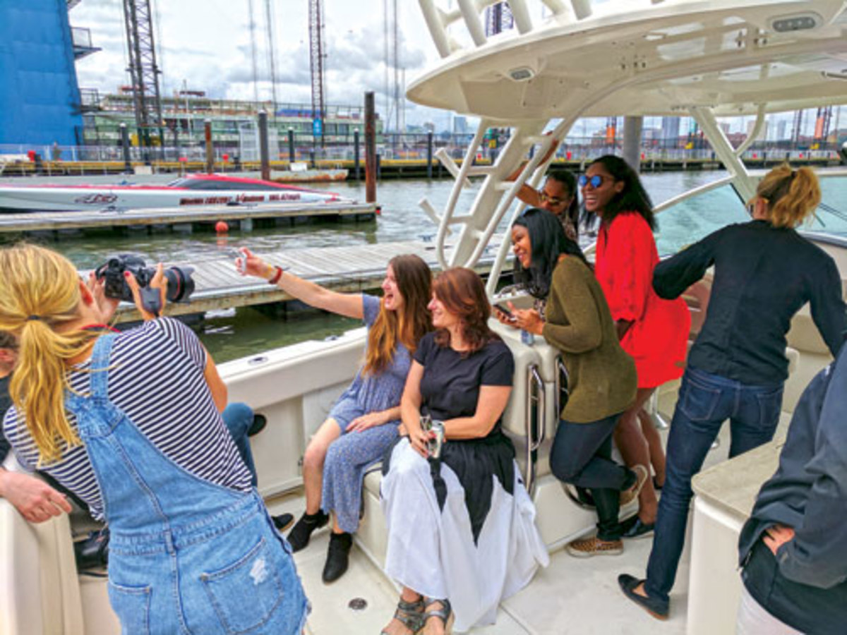 Boston media aboard Boston Whaler Photo