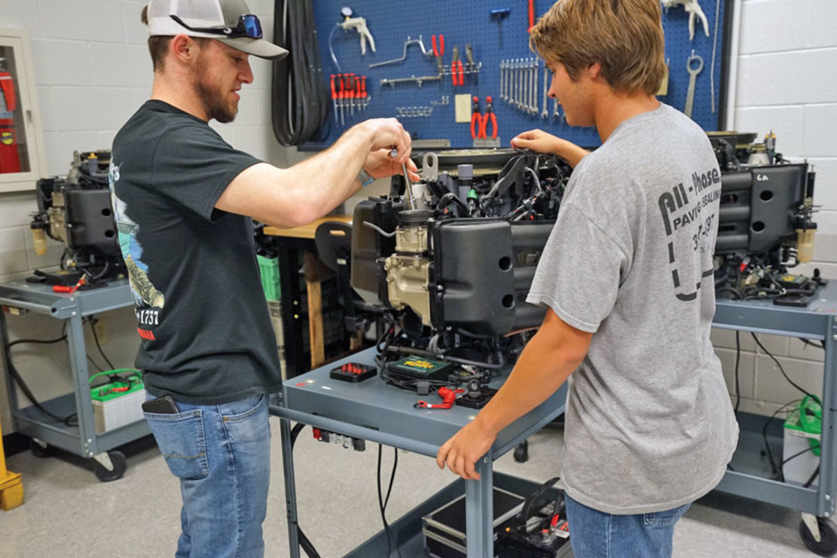 Students at Yamaha University get to work on the latest outboard motors.