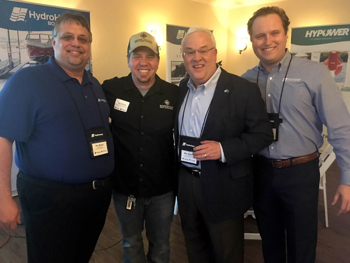 Pictured (l to r) Ron Martin, HMG director of sales; Alex Broat, a dealer; Mick Webber, HMG CEO and president; and Cale Grauer, business development manager.