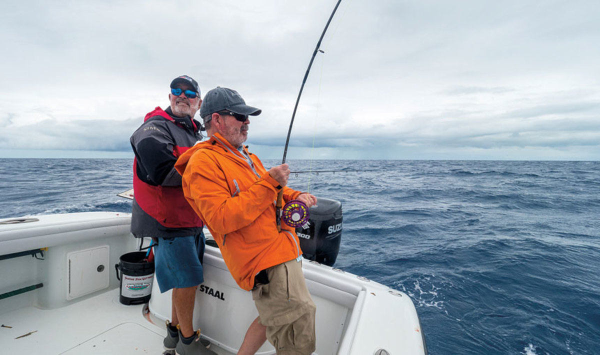 Bill Sisson (right) bends a rod off the Florida Keys, with guide R.T. Trosset.