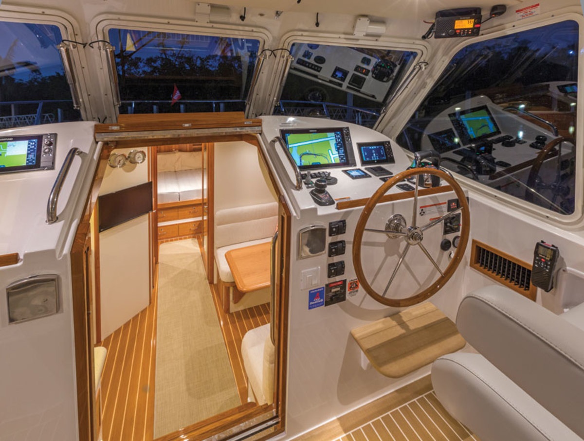 The helm of  the MJM 43z  has all the modern amenities including a multifunction display and joystick controls for the boat's Mercury outboards.