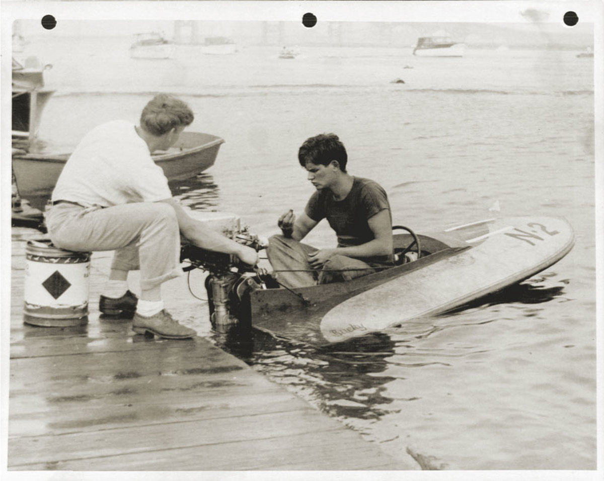 Early in his competition days, a teenage Strang (in boat) prepares for a race.