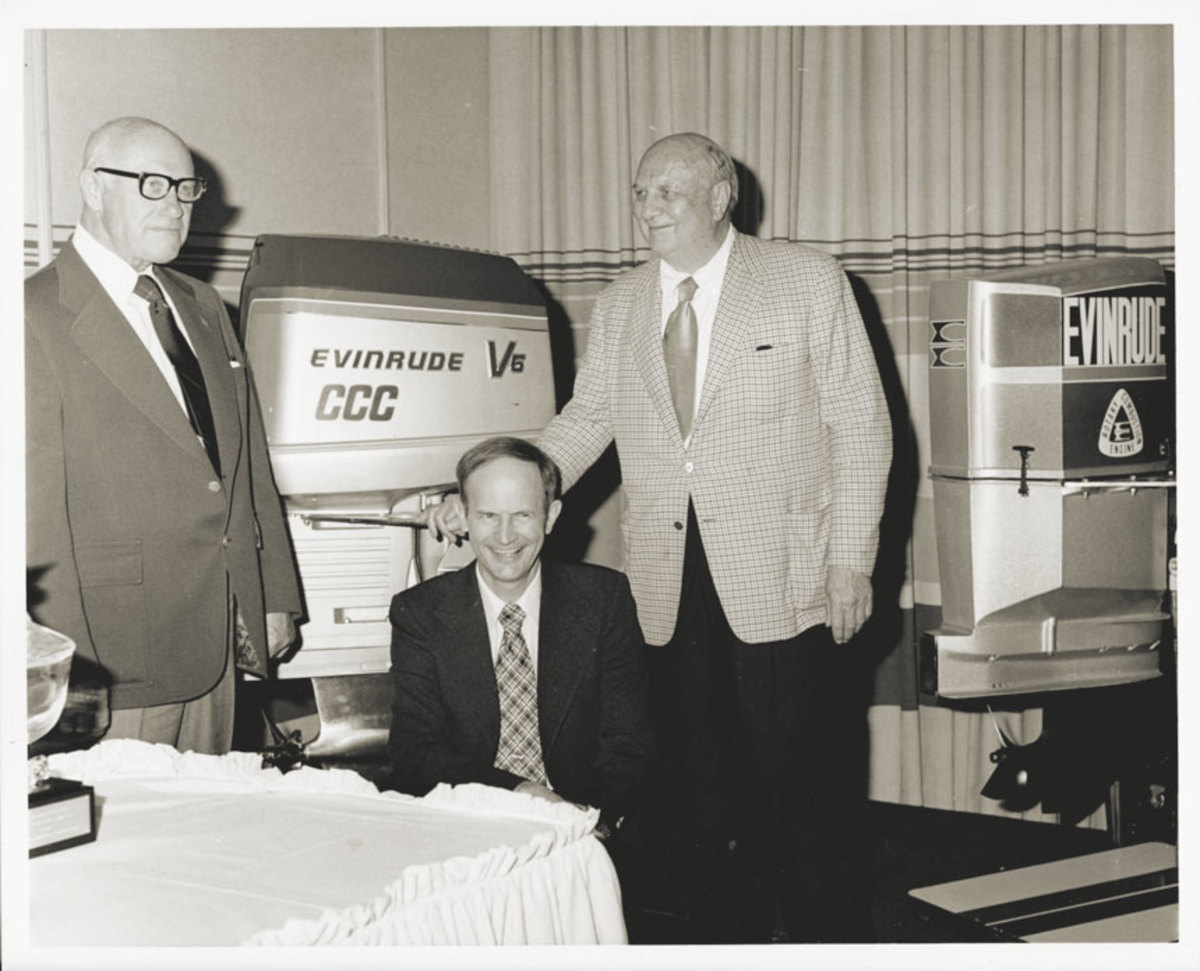 Left,  Strang (seated), Carl Kiekhaefer (glasses) and Ralph Evinrude at a press luncheon.