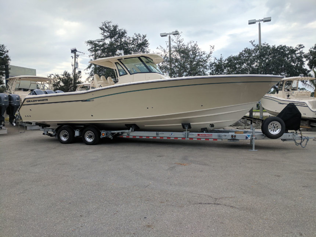 A hydraulic trailer makes it easy for a dealer to pick up and move a variety of boat sizes and styles.