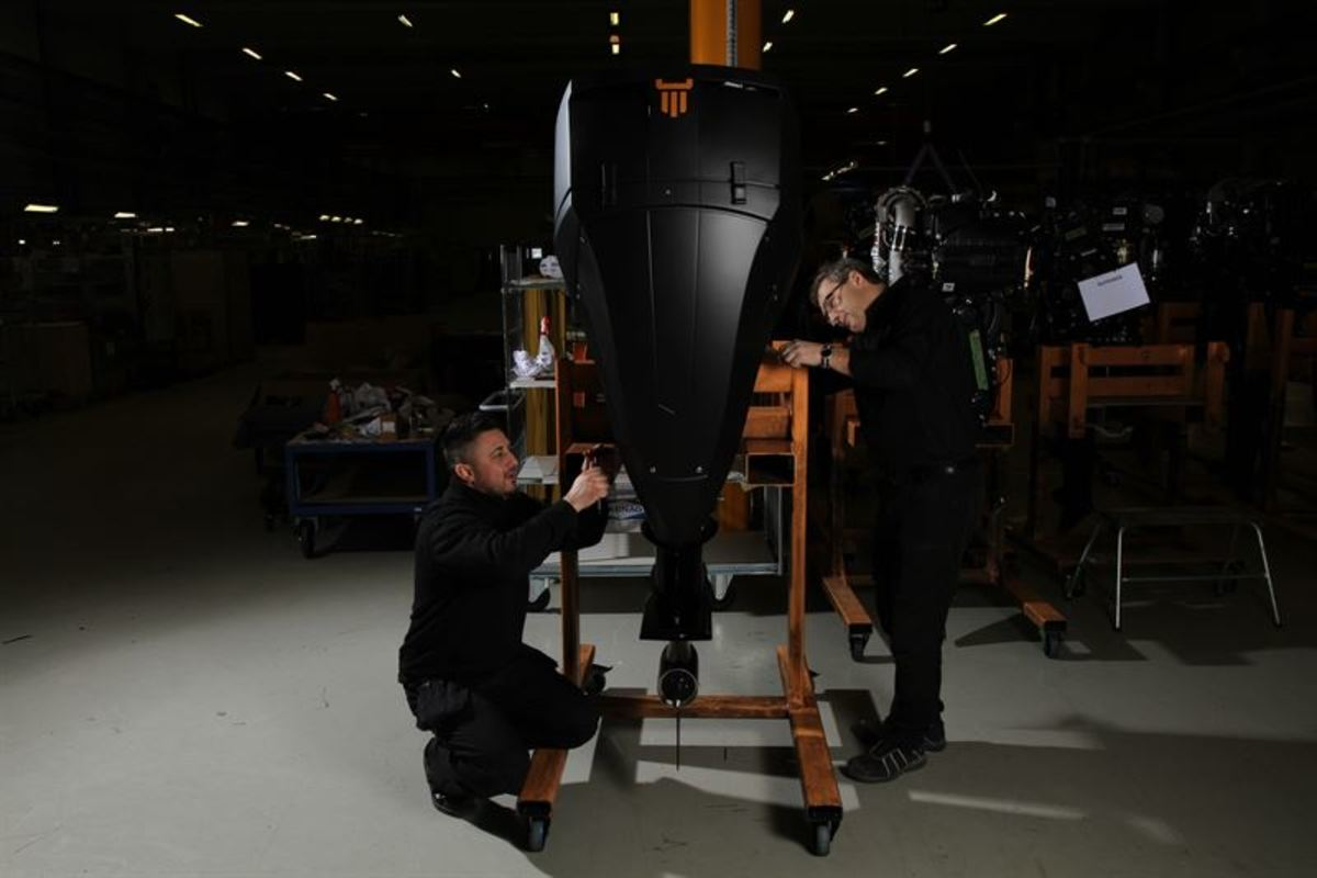 Technicians working on a prototype of the new diesel outboard