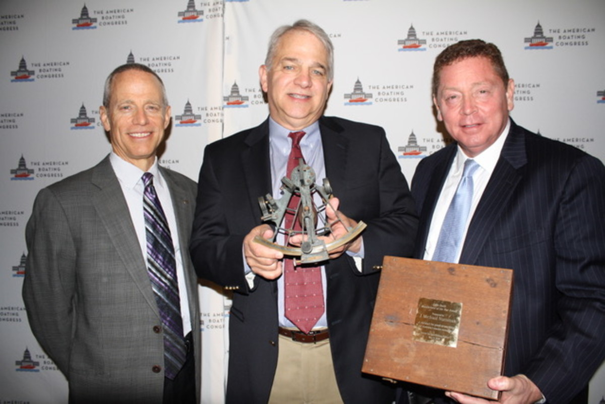 Mike Nussman received the Eddie Smith Award at the American Boating Congress. From left to right, Shimano president and CEO Dave Pfeiffer, who won the Eddie Smith Award last year; Nussman; and CSP president Jeff Angers.