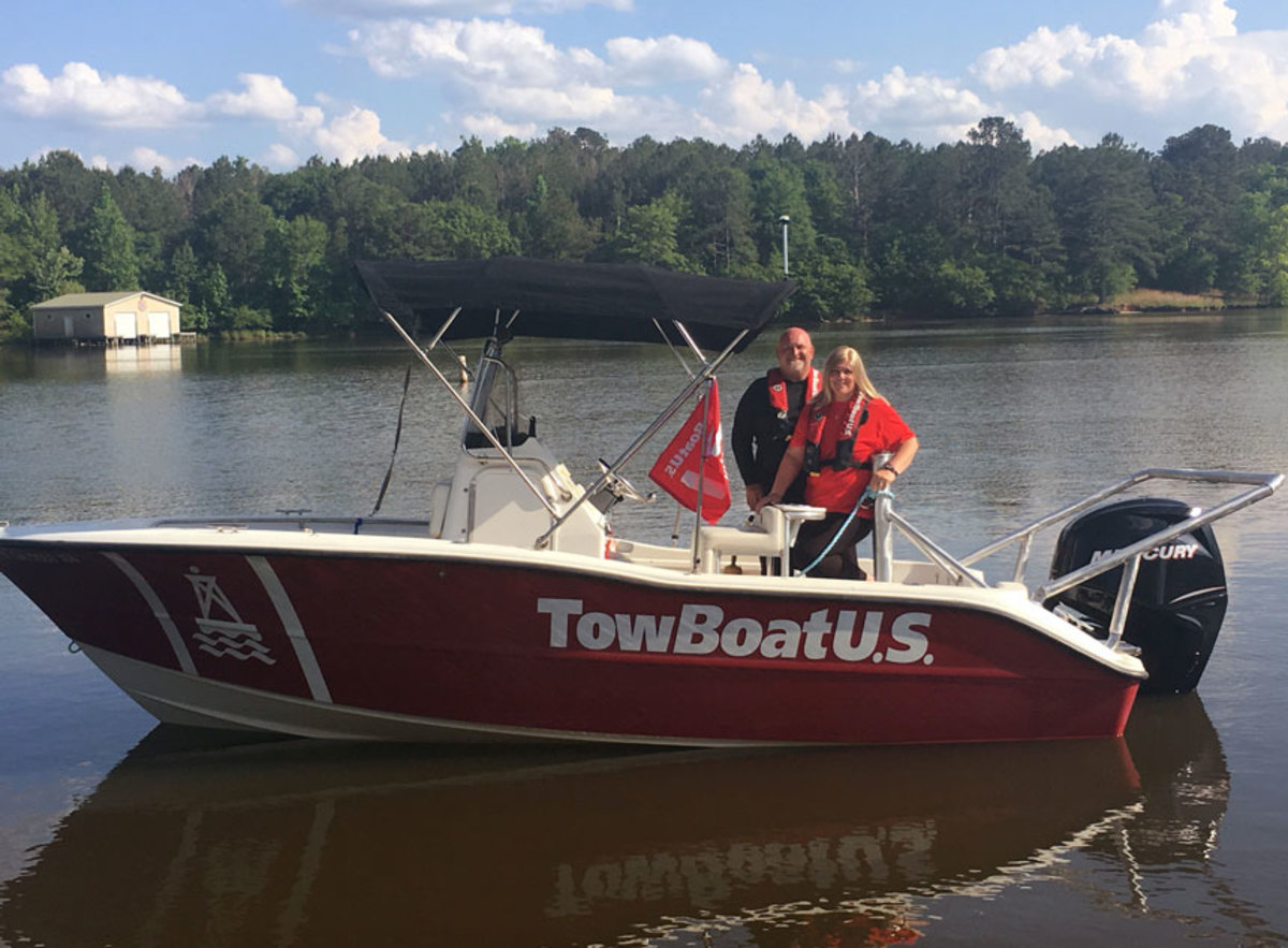 Daniel and Brandy Whitby, new owners of TowBoatUS Lake Oconee, aboard one of their 24-hour on-water assistance company's response vessels.