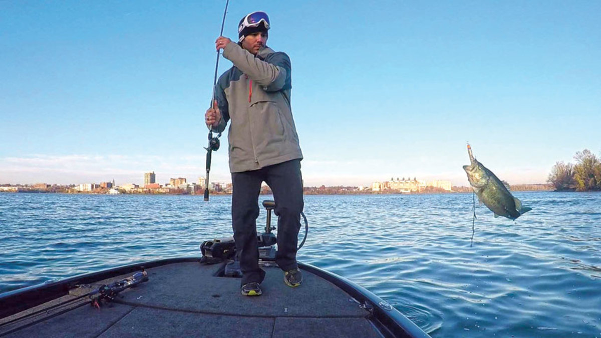 Angling enthusiast Lou Martinez lands a fish on his new Skeeter  ZX250  bass boat.