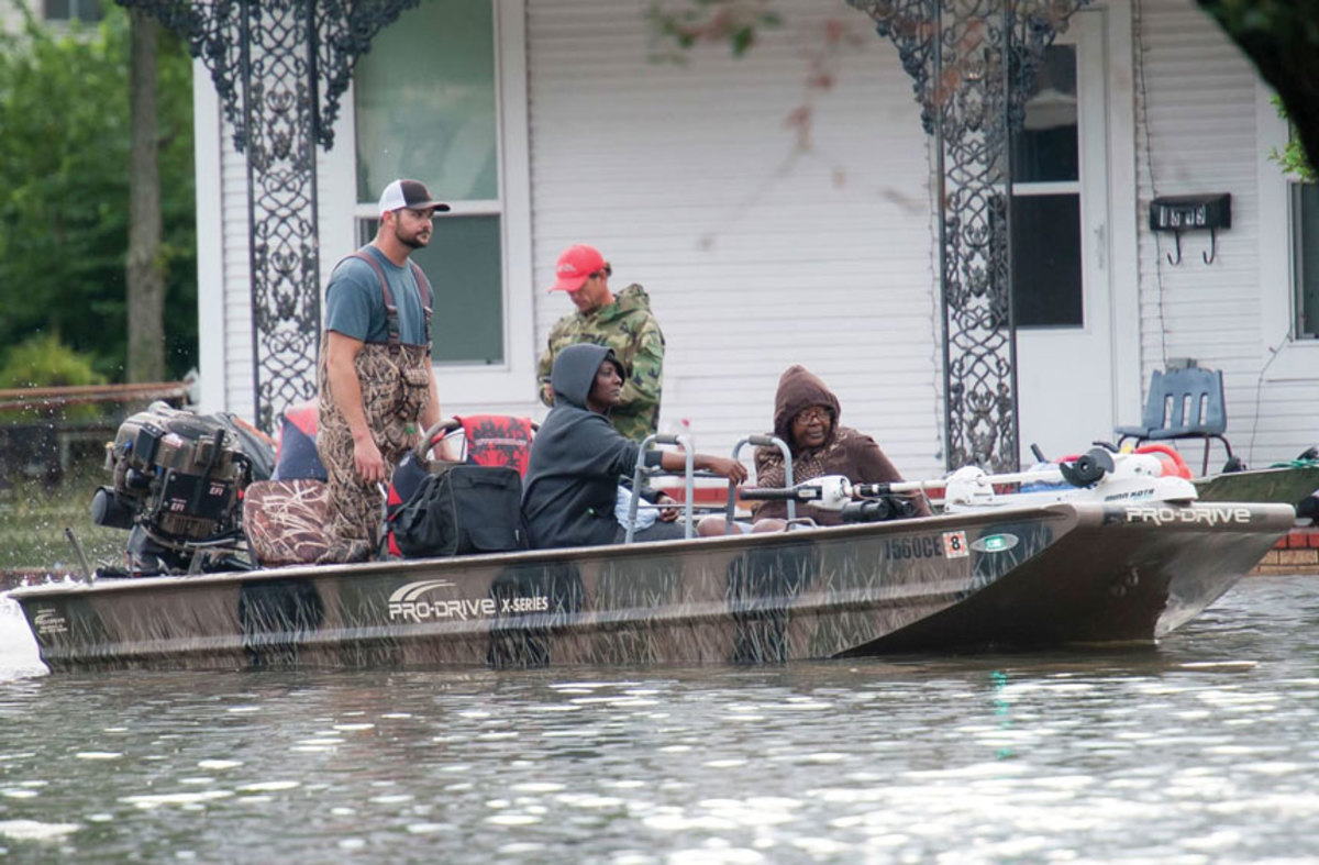 Residents are carried to safety aboard a rescue boat in Port Arthur, Texas, which was flooded by Hurricane Harvey. Photo Courtesy of: US Army National Guard.
