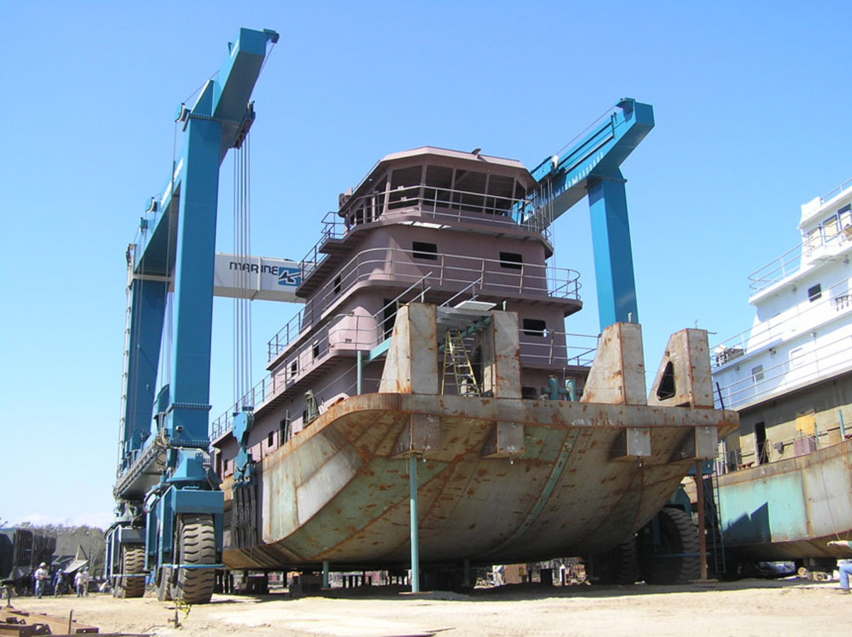 A steel tug built by Horizon Shipbuilding on the 660-ton Travelift at Metal Shark's newly-acquired Alabama Shipyard