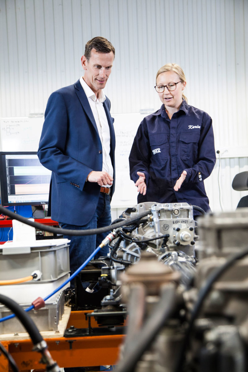 Volvo Penta's chief technology officer, Johan Carlsson, and system engineer, Karin Åkman, discuss electromobility at the company's development-and-test laboratory in Gothenburg.