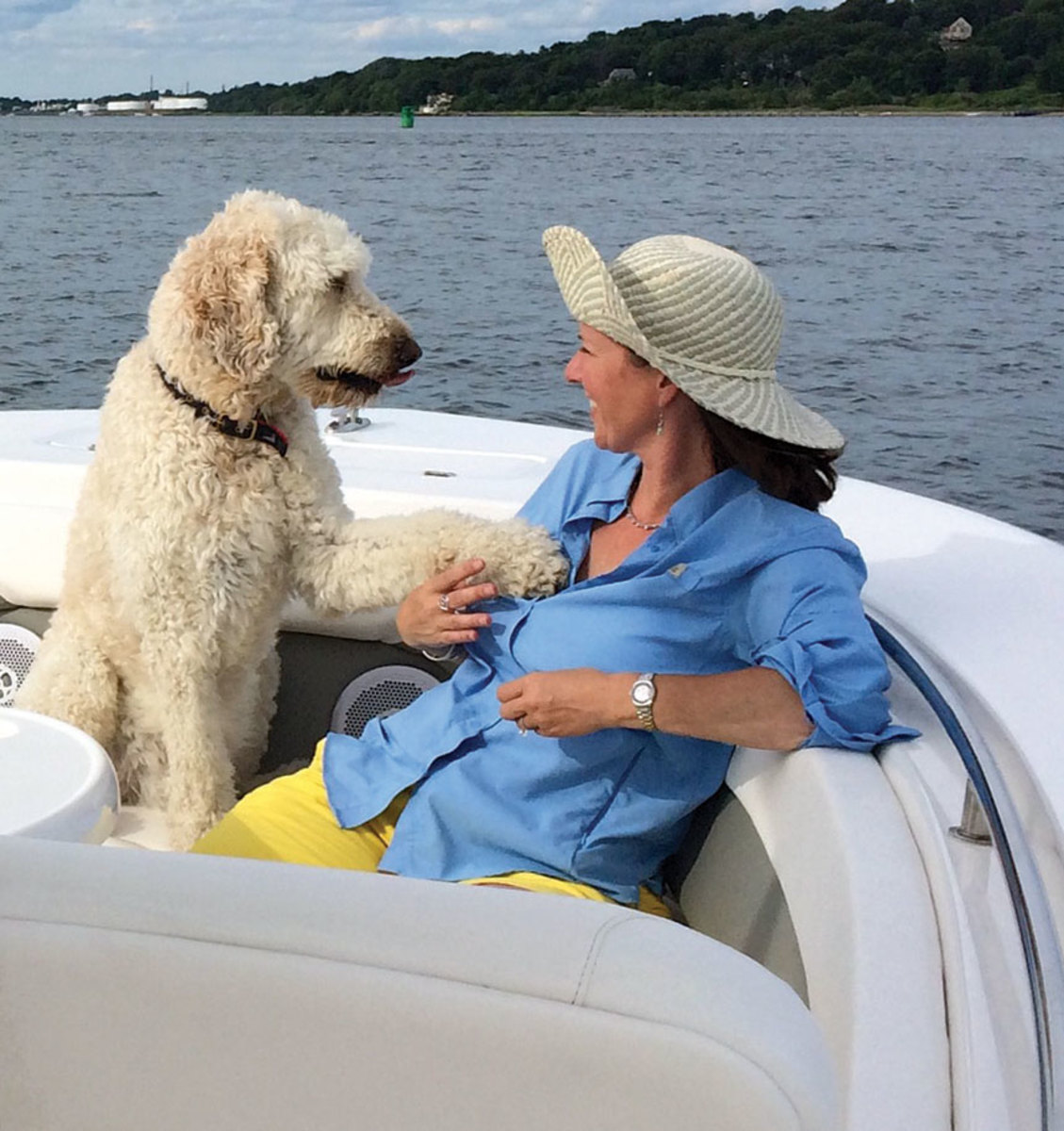 In a rare moment of free time, Mackie enjoys the company of her friend's dog Frisco on a Freedom Boat Club outing.