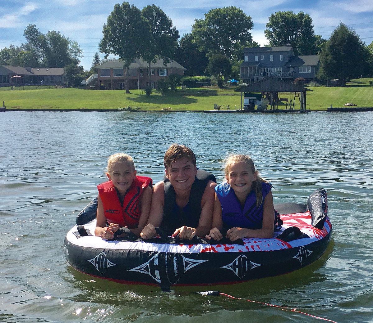 Tyler is flanked by Kendall (left) and Camryn as they prepare for a tube ride.