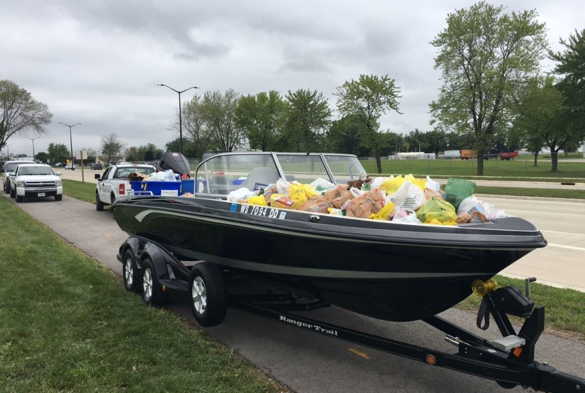 One of several boats that were filled with food is ready delivery to the Fondy Food Pantry.