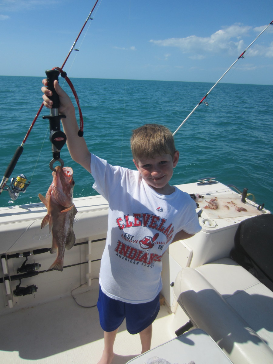 Tyler Kin, 7, with his first fish.