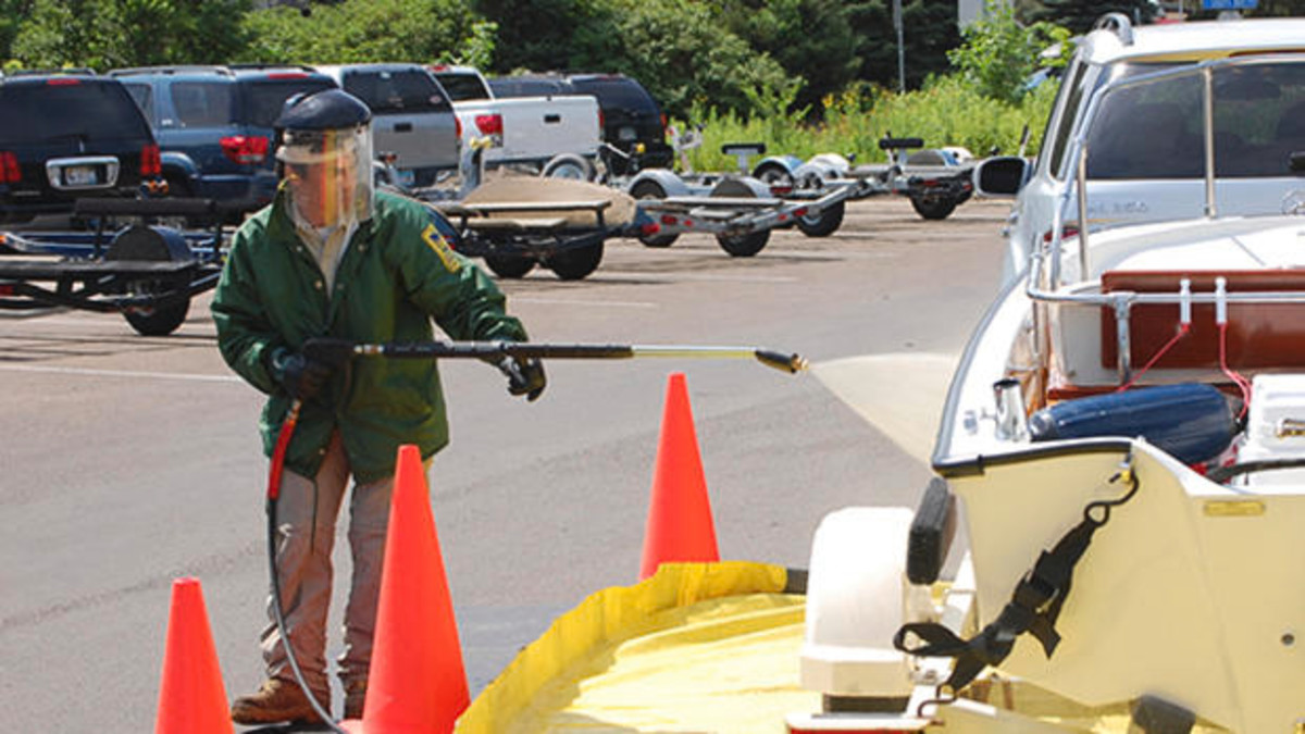 Methods used to reduce the spread of invasive species include sterilizing boats before launching them in new waterways.