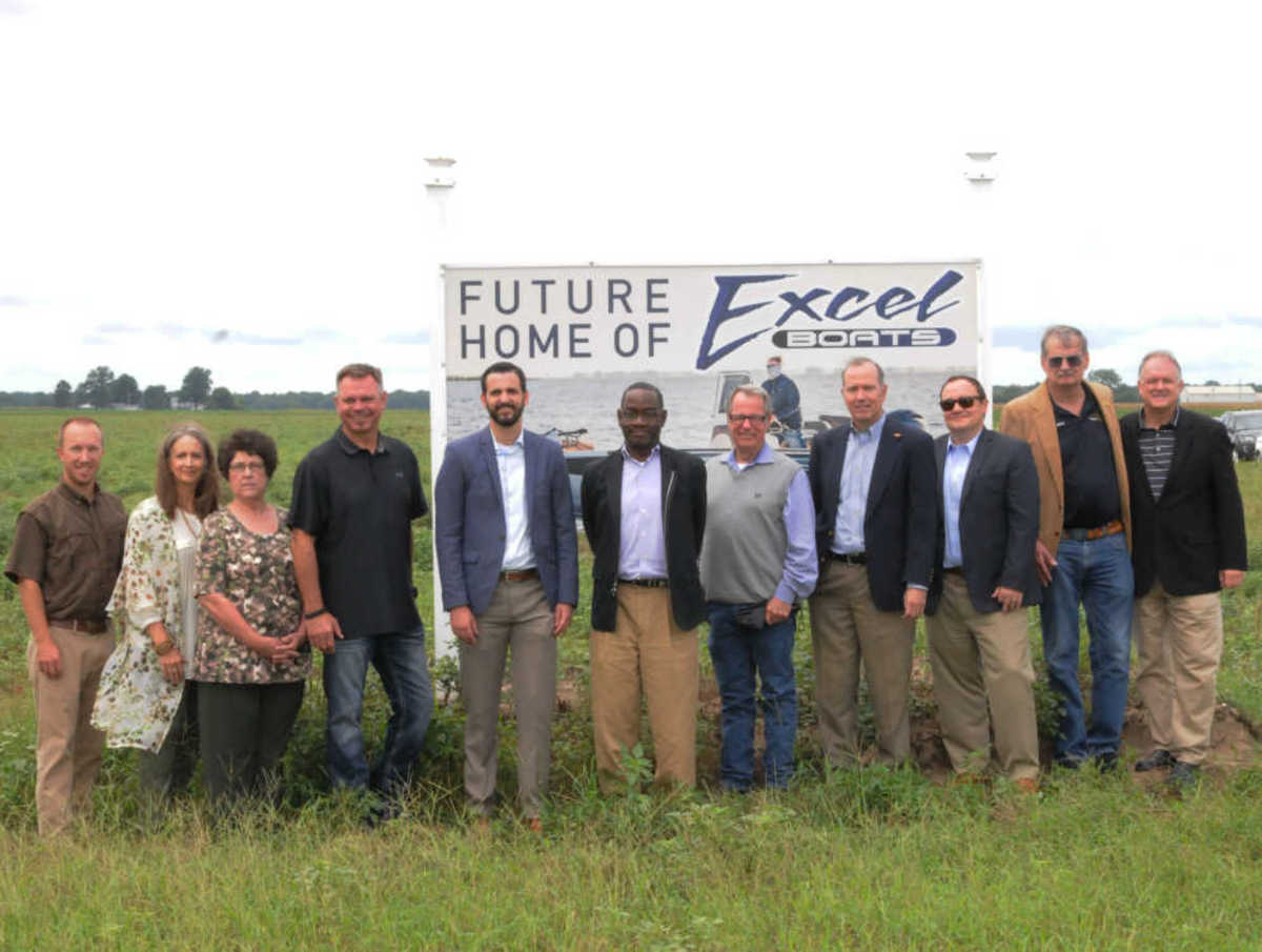 Executives from Excel Boats, local government officials and private-equity groups in front of Excel's future facility in Ridgely, Tenn.