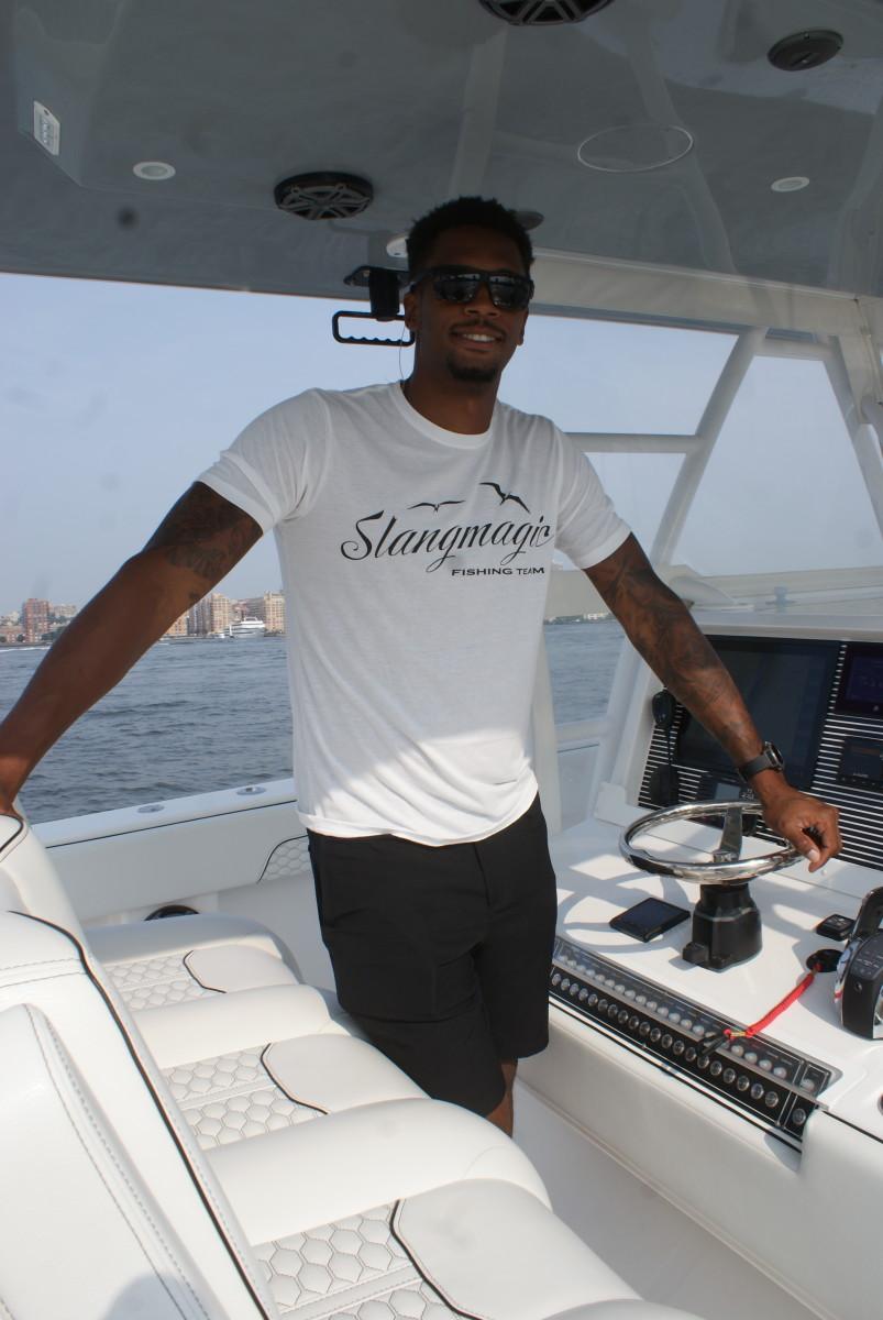 Lance Thomas, a professional basketball player for the New York Knicks, aboard his 40' Invincible catamaran, Slangmagic.