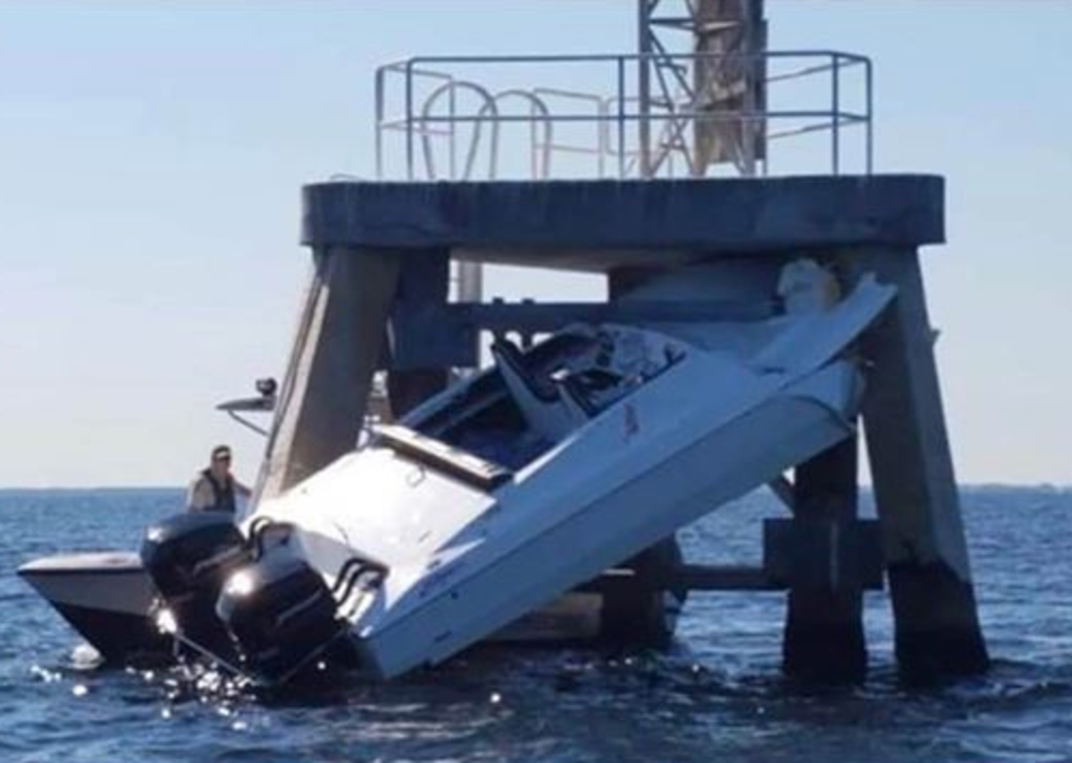 The 28-foot catamaran hit a range marker early Saturday morning.