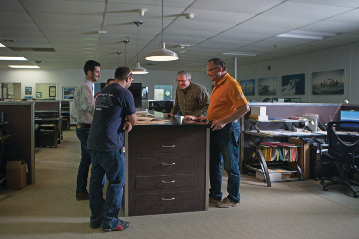 """At the """"brainstorming table"""" in Cadillac, engineers, naval architects and customer service personnel gather to share ideas."""