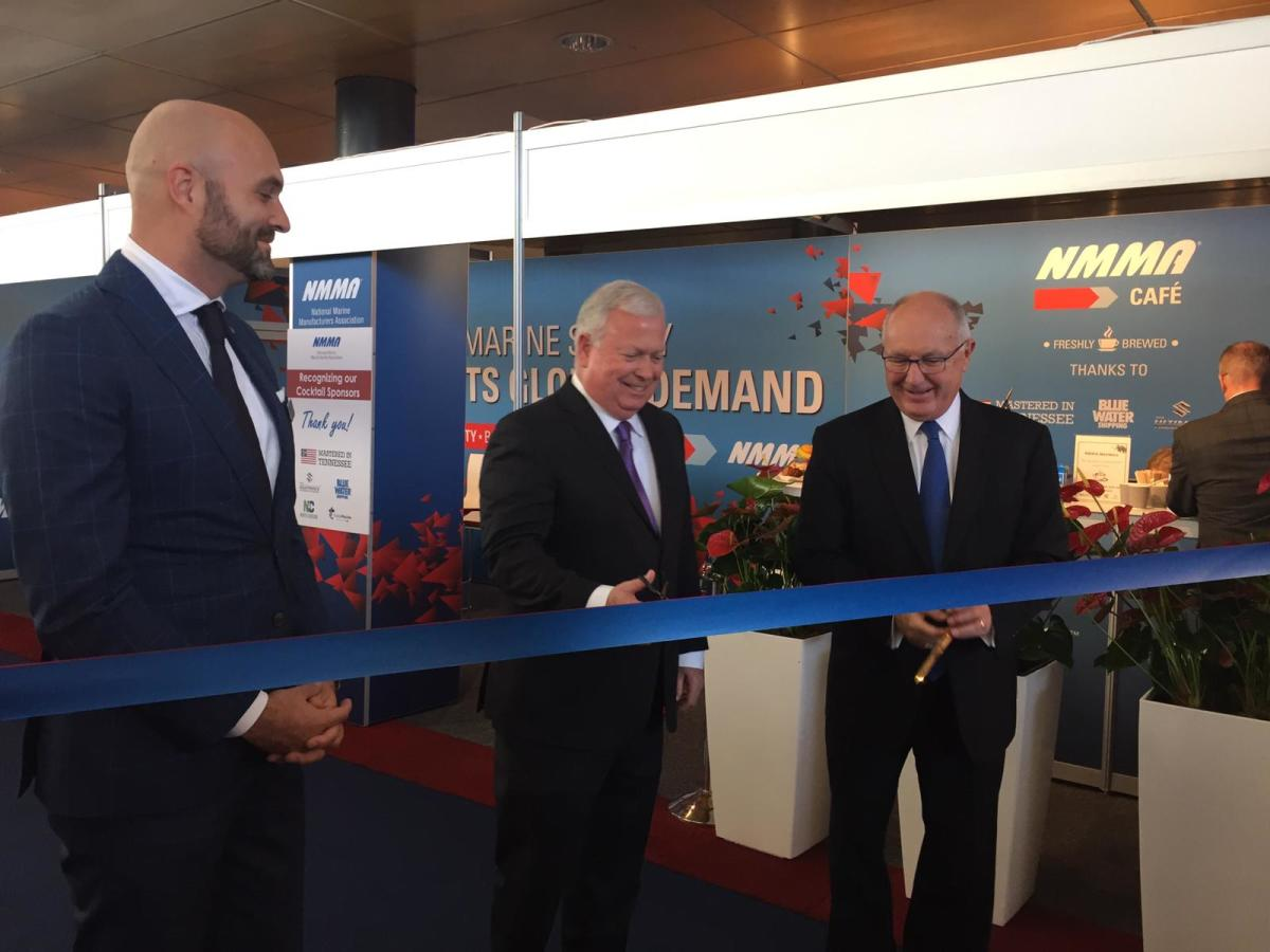 NMMA president Thom Dammrich (center with scissors) cuts the ribbon at the new U.S. Pavilion at Metstrade this morning.
