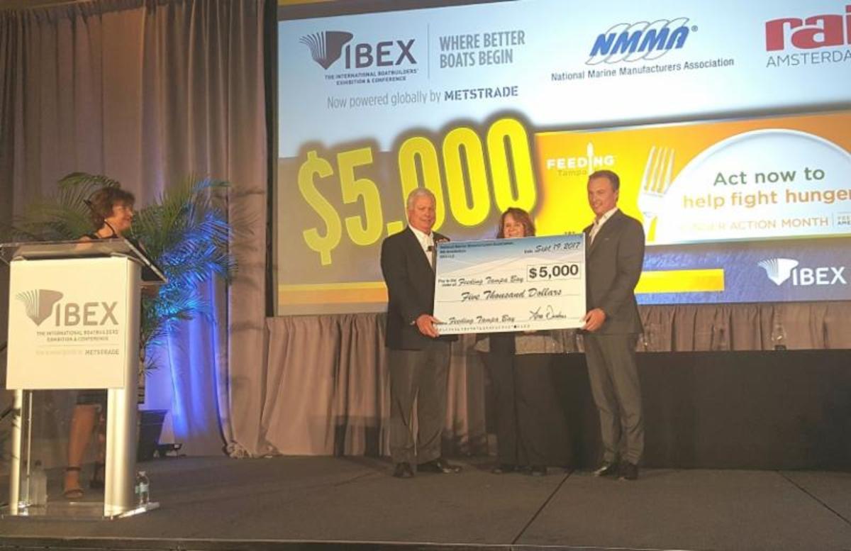 Big check for Feeding Tampa Organization