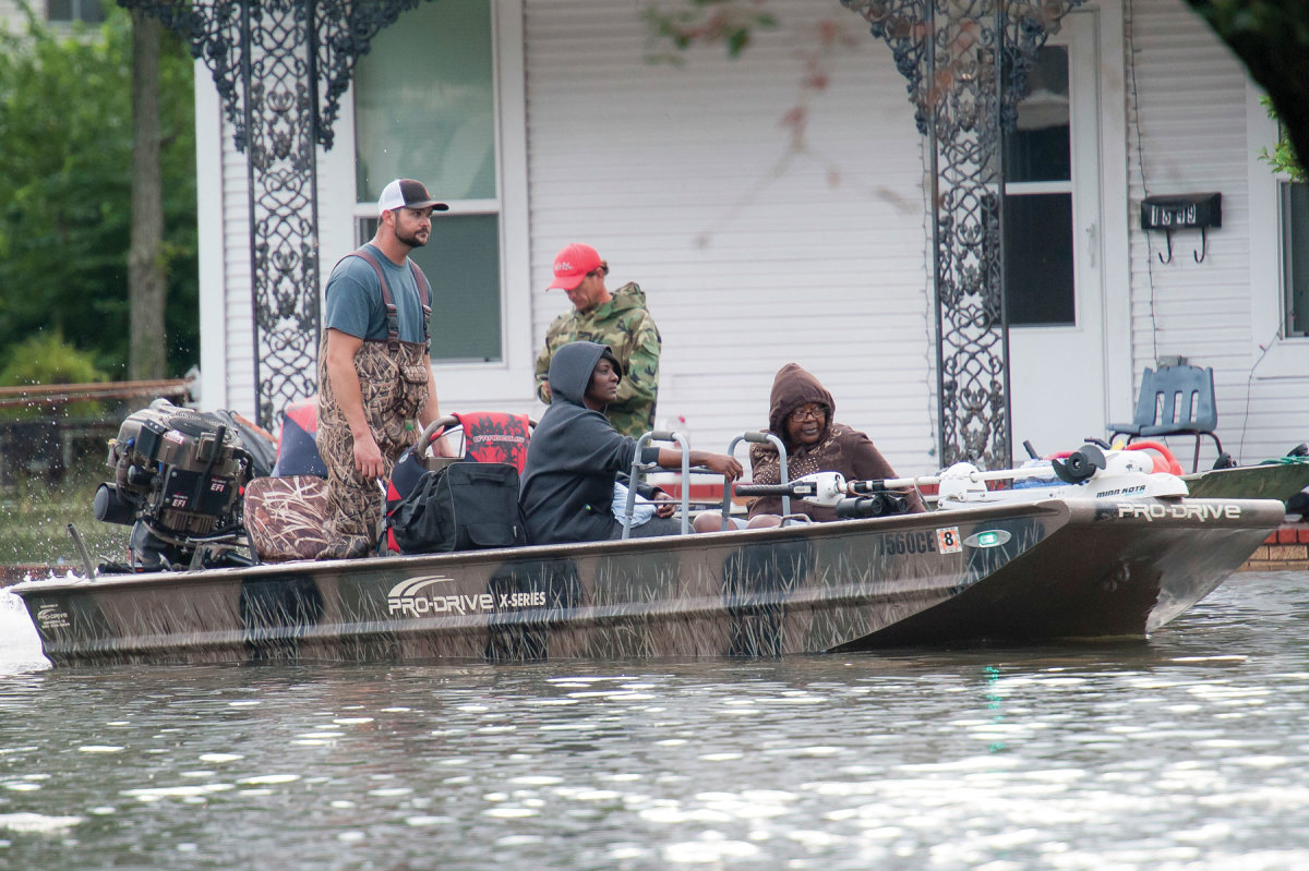 Residents are carried to safety aboard a rescue boat in Port Arthur, Texas, which was flooded by Hurricane Harvey.
