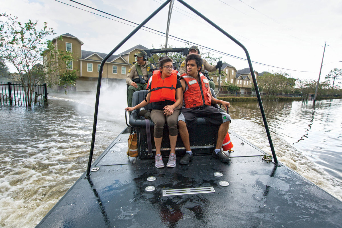 U.S. Border Patrol riverine agents evacuate residents from a flooded Houston neighborhood.