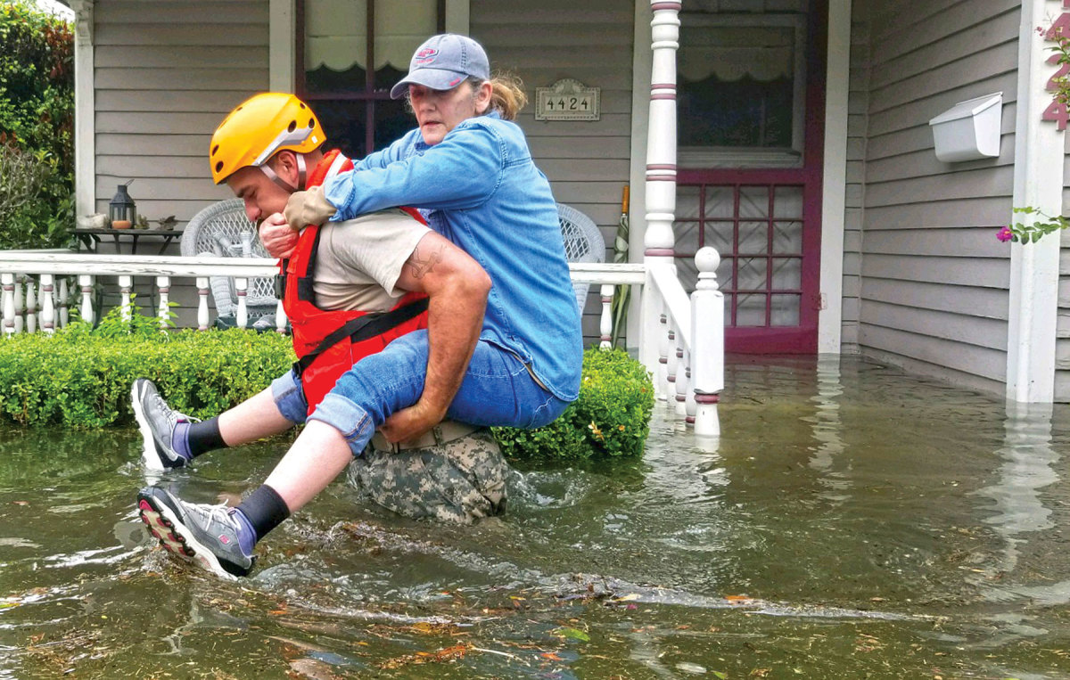 A Texas Army National Guard soldier rescues a Houston resident.