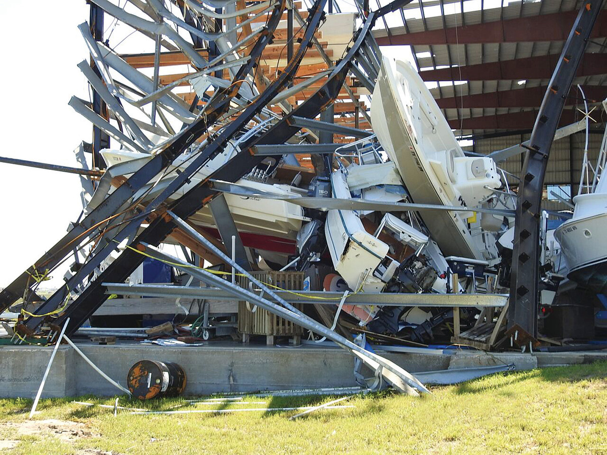 Boats are tangled amid twisted metal in a drystack at Cove Harbor Marina in Rockport, Texas.