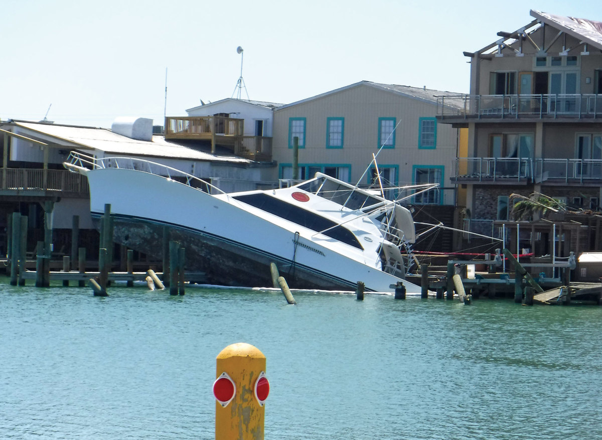 This sportfishing boat is shown sunk at its stern at Port Aransas, Texas.