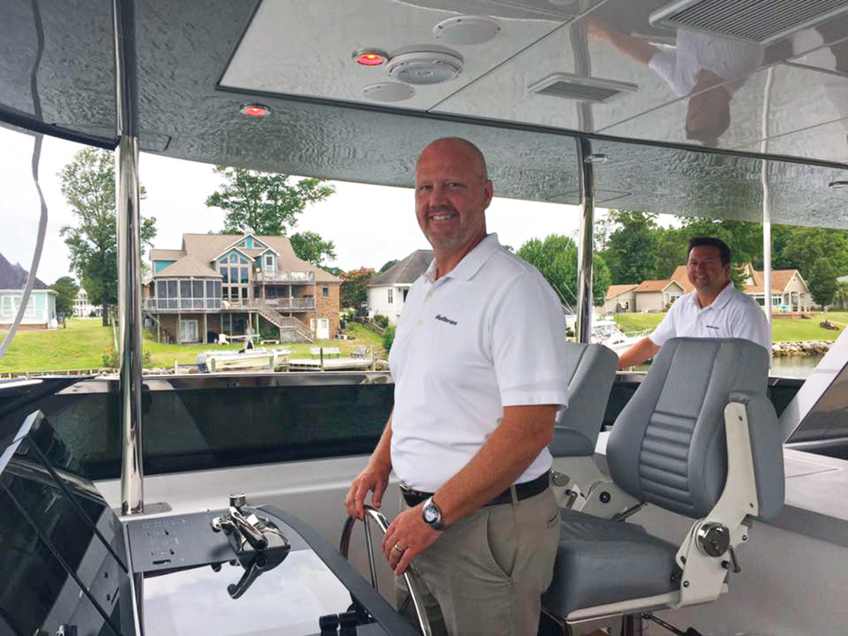 Kelly Grindle at the helm of the new M90 Panacera, on which the HattCON yacht management system is standard equipment.