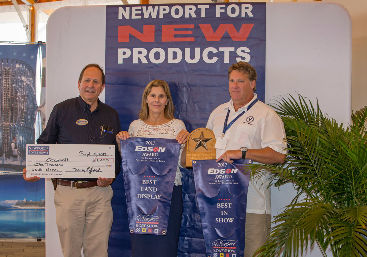 Oceanvolt, of Annapolis, Md., received the Edson 2017 Star of the Show Plaque for best overall display. Shown are Will Keene, chairman of Edson International; Nancy Piffard, show director of the Newport Exhibition Group; and Bill O'Malley, North American sales manager at Oceanvolt.