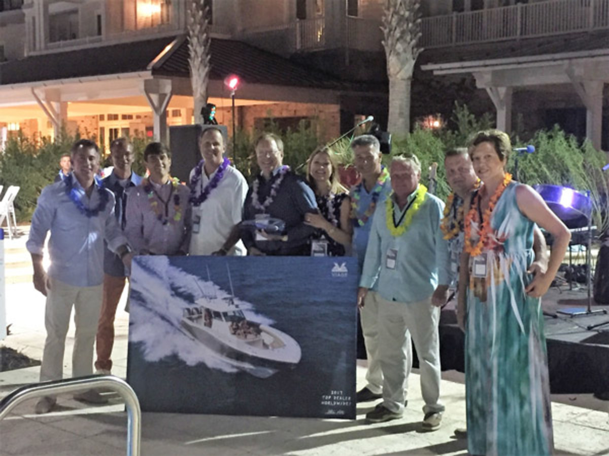 Viage Group Sarasota (Fla.) won dealer-of-the-year honors at Scout's meeting.