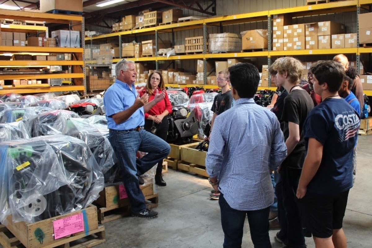 Mark McKinney, president of Correct Craft-owned Pleasurecraft, led a group of local students through a factory tour.