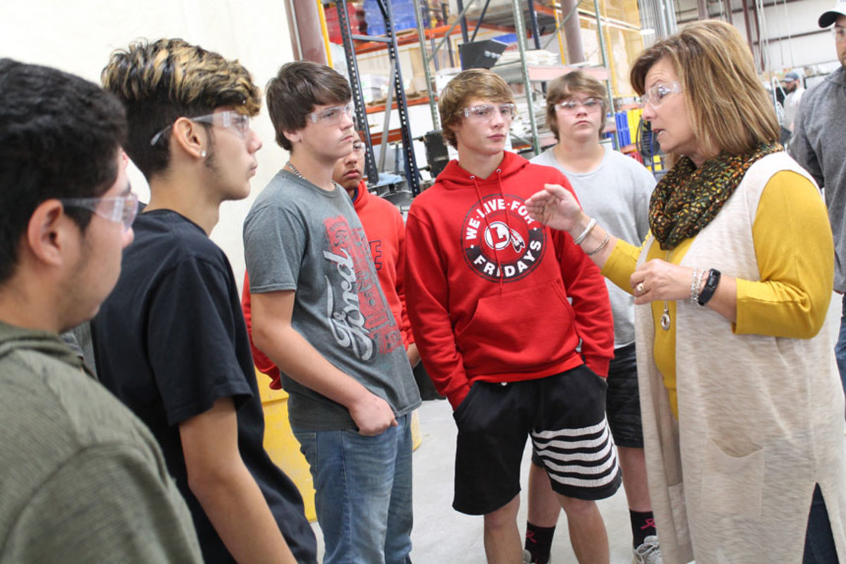 Debbie Kent, vice president of human resources for Malibu Boats, talks to students who visited the company's Tennessee plant for a Manufacturing Day event.