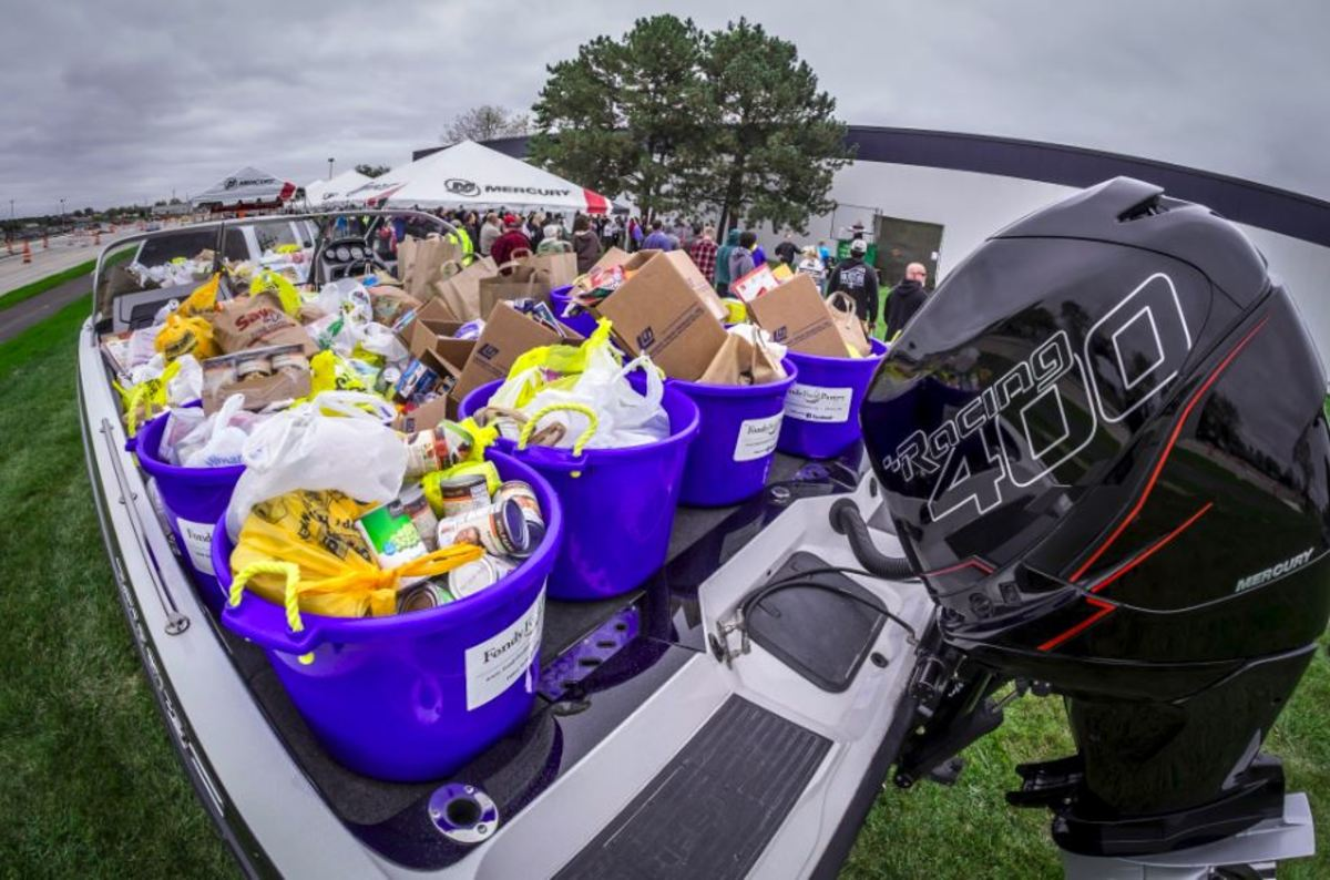 """Mercury Marine employees in Wisconsin donated food and cash to a local food pantry as part of the company's """"Fill the Boat to Cast Out Hunger"""" food drive."""