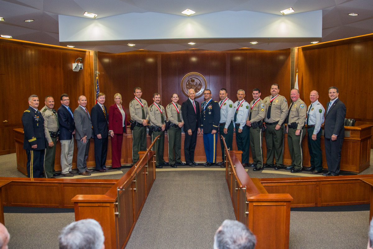 Gov. Rick Scott (center) handed out honors to a National Guard officer and seven state law enforcement officers at a meeting of the Florida Cabinet.