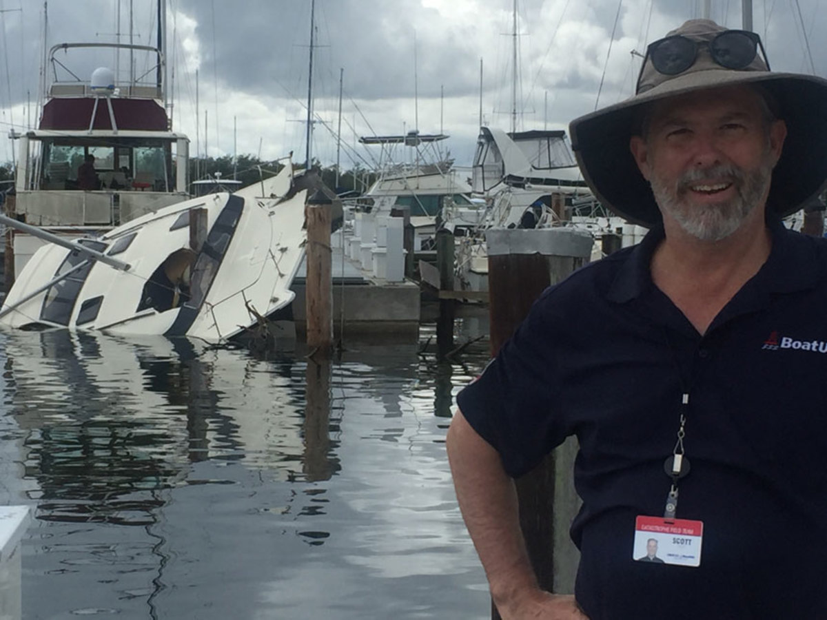 Scott Croft, vice president of public affairs for BoatUS, is shown near a catamaran the company insures.