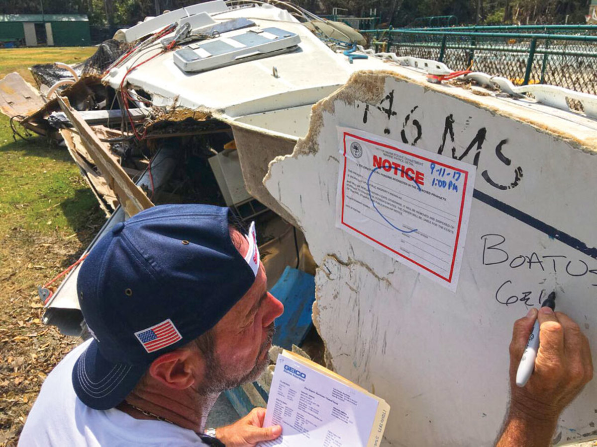 BoatUS CAT Team member Terry Hill assesses boat damage after Hurricane Irma.