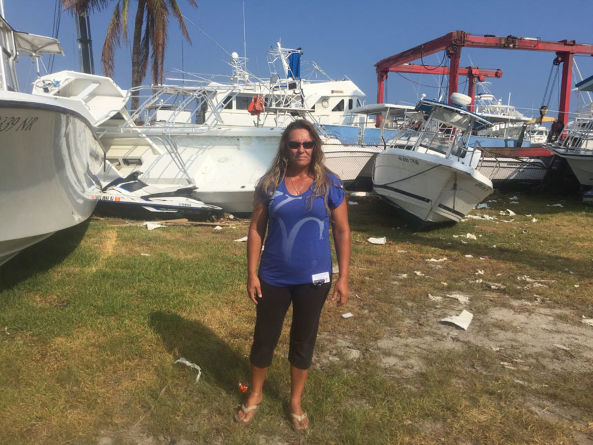 Shelly Breedlove, manager of Driftwood Marina and Storage in Marathon, Fla., is shown with a tangle of boats and debris.