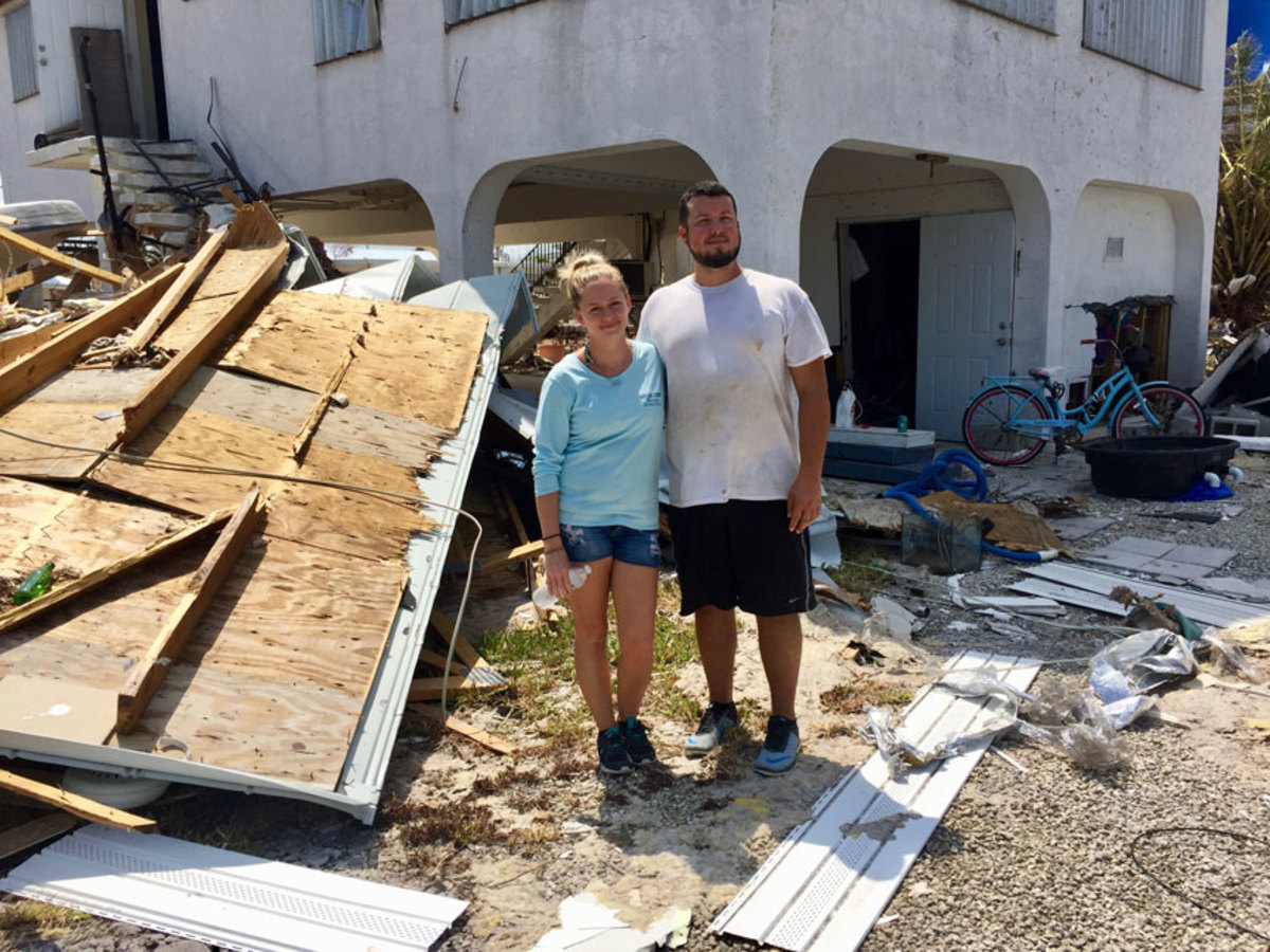The home of Misty Klock and her boyfriend, Alan Cox, was badly damaged, but their boat weathered the storm.