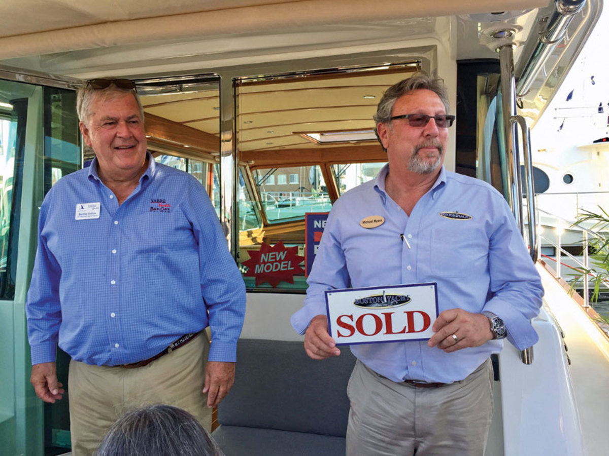 Michael Myers (right) of Boston Yacht Sales sold a Sabre 45 Salon Express at the show. At left is Bentley Collins, sales and marketing vice president at Sabre Yachts.