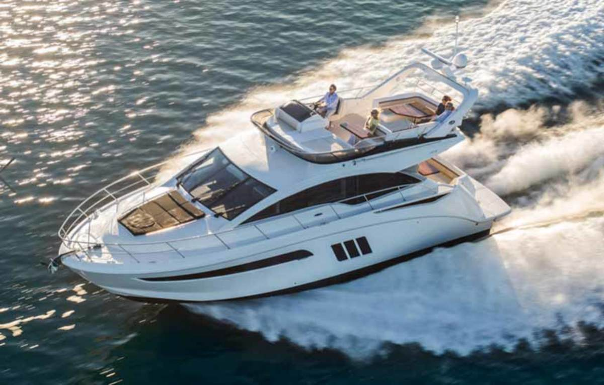 Brunswick Corp. lowered its earnings expectations in part because of sluggish demand for its boats from 41 to 65 feet, such as this Sea Ray Sundancer 510 Fly, in the second and third quarters.