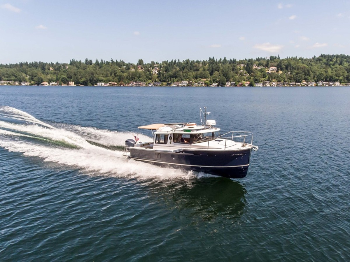 The Ranger R27 is a tug-style boat with an outboard.