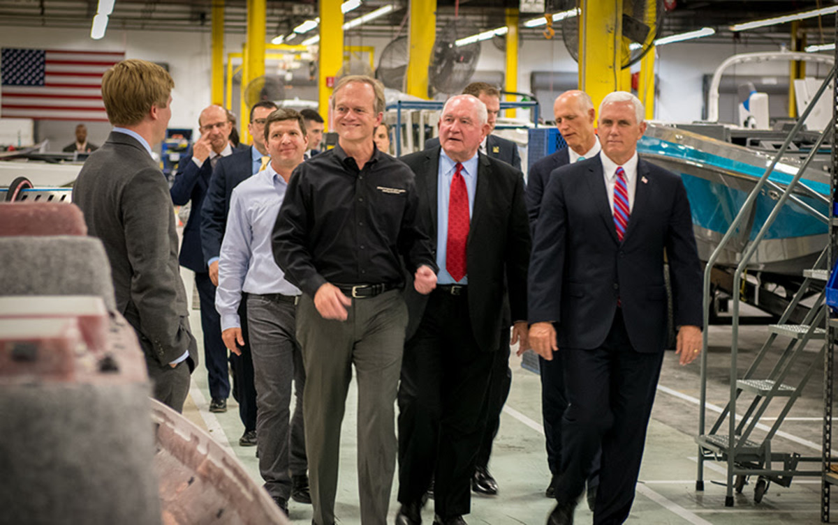 Vice President Mike Pence (right), Florida Gov. Rick Scott (behind Pence) and U.S. Agriculture Secretary Sonny Perdue (center) toured Nautique Boat Co. on Thursday. Correct Craft CEO Bill Yeargin is at left.